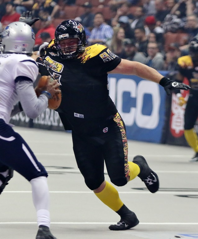 Gustave Benthin and the LA Kiss d-line get pressure on Portland quarterback Darron Thomas. (Photo by Duane Barker)