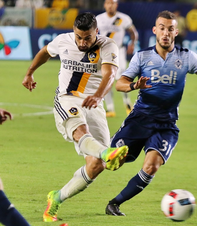 Sebastian Lletget boots a blast that didn't find the back of the net. (Photo by Duane Barker)