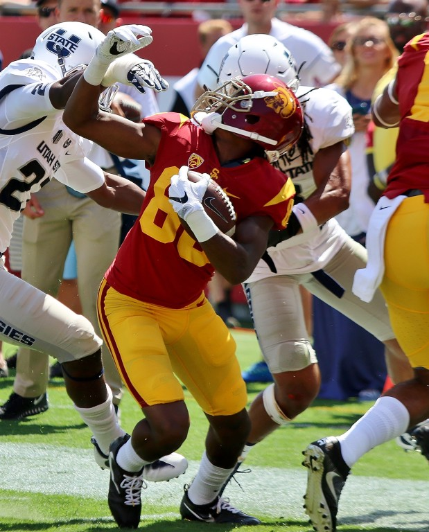 Deontay Burnett fights through the facemask and gets the Trojans on the board. (Photo by Duane Barker)