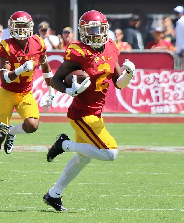 Adoree' Jackson goes 77 yards to paydirt on a punt return. (Photo by Duane Barker)