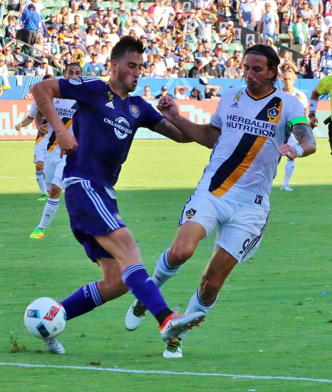 Did Alan Gordon draw a penalty on this one? The ref thought so! (Photo by Duane Barker)