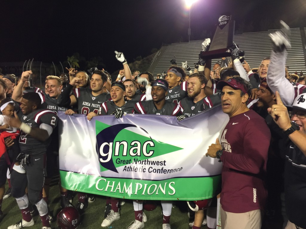 The APU Cougars hoist the GNAC Title banner and hardware!