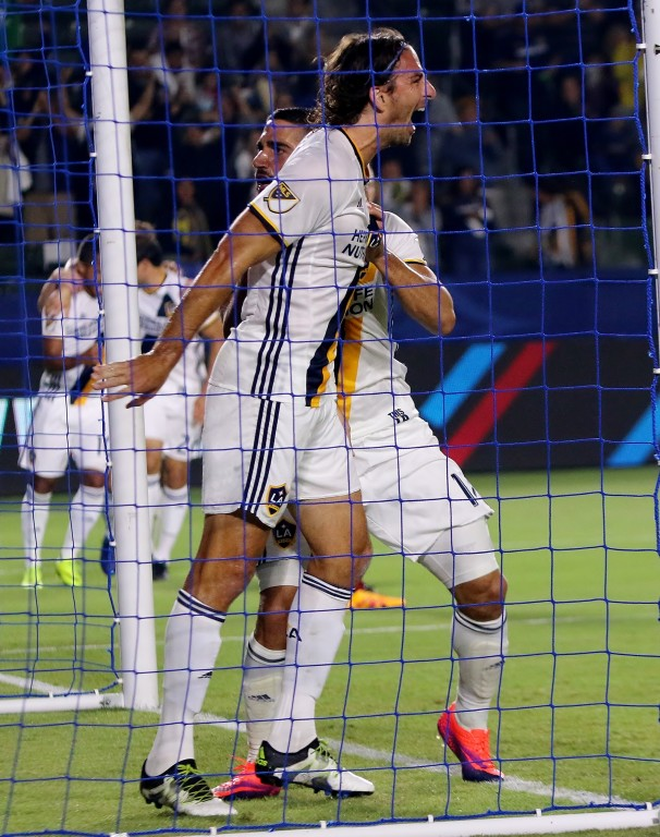 Alan Gordon and Sebastian Lletget celebrate Gordon's goal.