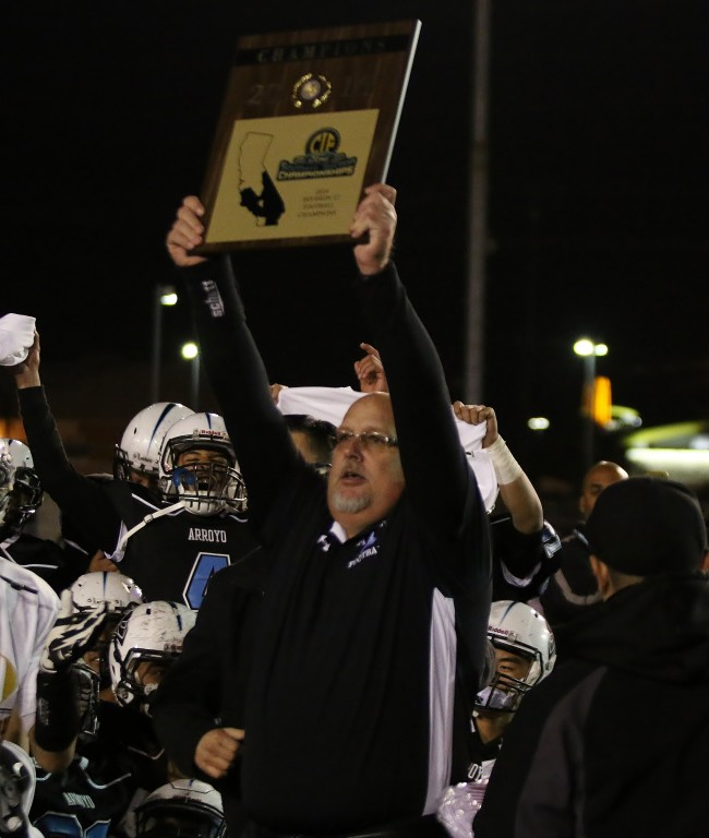 Arroyo head coach Jim Singiser hoists the championship hardware!
