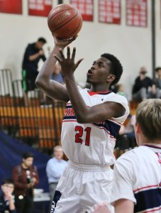 Marcus Reedy glides to the hoop for the Minutemen. (Photo by Duane Barker)
