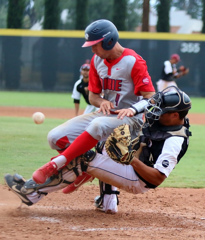 There was a collision at the plate in the fifth inning. The runner was ruled out. (Photo by Duane Barker)