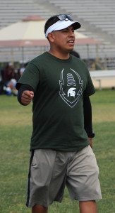 Eric Elias working with the offense at Schurr